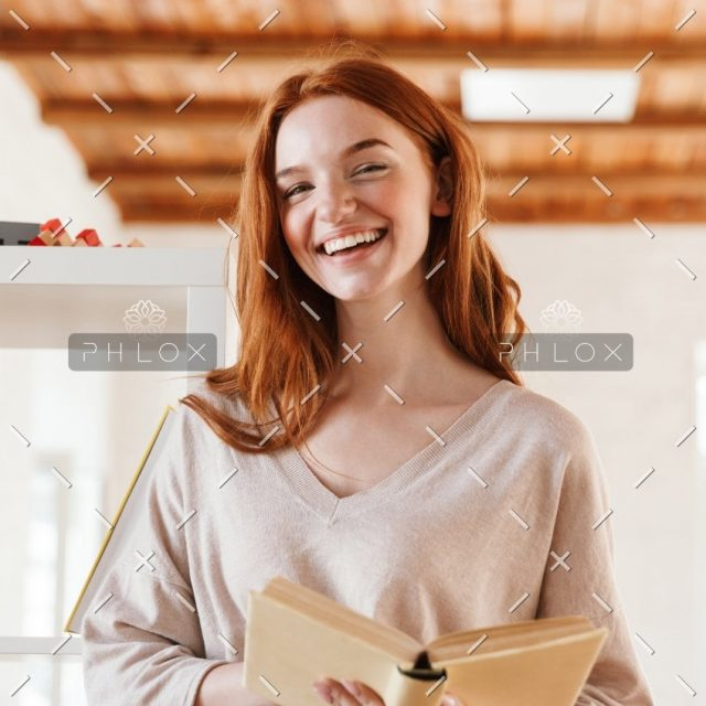 demo-attachment-445-happy-redhead-young-lady-student-reading-book-M5Z7RVC@2x-1